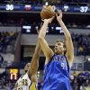 Photo - Dallas Mavericks forward Dirk Nowitzki (41) shoots in front of Indiana Pacers forward David West during the first half of an NBA basketball game in Indianapolis, Wednesday, Feb. 12, 2014.  (AP Photo/Michael Conroy)