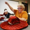 Beverly Terry pulls her needle through the fabric. A dozen women came to the Oklahoma History Center on Saturday, Feb. 1, 2014, to learn the art of hat-making from volunteer Barbara who conducted the day-long milliner class at the Oklahoma Historical Society. Photo by Jim Beckel, The Oklahoman