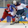 Photo - Czech Republic defenseman Michal Rozsival and USA forward David Backes battle for control of the puck during the second period of men's quarterfinal hockey game in Shayba Arena at the 2014 Winter Olympics, Wednesday, Feb. 19, 2014, in Sochi, Russia. (AP Photo/Matt Slocum)