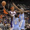 Photo -   Phoenix Suns forward Michael Beasley looks to pass as Denver Nuggets point guard Ty Lawson (3) and Corey Brewer, right, defend during the second half of a preseason NBA basketball game, Friday, Oct. 26, 2012, in Phoenix. (AP Photo/Matt York)