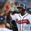 Photo - Atlanta Braves' Justin Upton (8) is greeted by his teammates at the dugout after hitting a solo-home run in the fourth inning of a baseball game against the St. Louis Cardinals, Tuesday, May 6, 2014, in Atlanta. (AP Photo/John Bazemore)