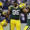Green Bay Packers cornerback Jarrett Bush (24) defensive end Datone Jones (95) and cornerback Tramon Williams (38) celebrate after beating Dallas Cowboys 37-36 at an NFL football game, Sunday, Dec. 15, 2013, in Arlington, Texas. (AP Photo/Tony Gutierrez)
