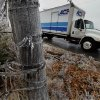 A thick coat of ice covers posts along NE 24th Street on Saturday, Dec. 21, 2013 in Norman, Okla. Photo by Steve Sisney, The Oklahoman