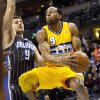 Denver Nuggets\' Andre Iguodala (9) drives to the basket past Orlando Magic\'s Nikola Vucevic (9) during the first quarter of an NBA basketball game, Wednesday, Jan. 9, 2013, in Denver. (AP Photo/Barry Gutierrez)