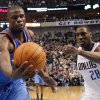 Oklahoma City\'s Nazr Mohammed (8) grabs a rebound in front of Dallas\' Ian Mahinmi (28) during the pre season NBA game between the Dallas Mavericks and the Oklahoma City Thunder at the American Airlines Center in Dallas, Sunday, Dec. 18, 2011. Photo by Sarah Phipps, The Oklahoman