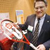 Jim Mason, CecD, Executive Director Oklahoma Nano Technology Initiative, holds a tennis racquet that uses nano technology to make it 22% more powerful and a washing machine that does not use hot water, it uses Silver Ions, at the Nano State Conference at the Cox Center, March 6,2008. Photo by DAVID MCDANIEL, THE OKLAHOMAN