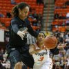 Oklahoma State\'s Tiffany Bias (3) passes the ball beside Baylor\'s Brittney Griner (42) during a women\'s college basketball game between Oklahoma State University and Baylor at Gallagher-Iba Arena in Stillwater, Okla., Saturday, Feb. 2, 2013. Photo by Bryan Terry, The Oklahoman