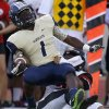 Southmoore\'s Nick Scott is brought down by Westmoore\'s Cassius Hill during their high school football game in Moore, Okla., Friday, Sept. 13, 2013. Photo by Bryan Terry, The Oklahoman