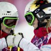 Photo - Canada's Justine Dufour-Lapointe, left, and Chloe Dufour-Lapointe bump fists as they are introduced for the women's moguls final at the Rosa Khutor Extreme Park, at the 2014 Sochio Winter Olympics, Saturday, Feb. 8, 2014, in Krasnaya Polyana, Russia. (AP Photo/The Canadian Press, Adrian Wyld)