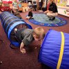 Students crawl through a tunnel in a classroom. In background, Public Education Specialist Casey Rooney directs the children. This exercise teaches the children to stay low to the ground on their hands and knees when escaping a room that is on fire or filled with smoke. Fire crews and public education officers with the Midwest City fire department talked about fire safety to pre-K students at Ridgecrest Elementary School, Thursday, Sep. 16, 2010. After the presentation, the students were treated to an up close look at a fire engine as firefighters from Station 3 showed them the features and equipment on their engine. Photo by Jim Beckel, The Oklahoman