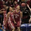 Photo - Oklahoma's Portia Durrett (31) celebrates with teammates Sharane Campbell, left, and Gioya Carter, middle, while DePaul's Megan Podkowa recovers the ball after Durrett scored and drew a foul which eventually pulled the Sooners within three points of DePaul during the second half of their first-round game in the NCAA basketball tournament in Durham, N.C., Saturday, March 22, 2014.  DePaul had led by as many as 19 points, and eventually beat Oklahoma 104-100.  (AP Photo/Ted Richardson)