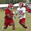 Jonathan Miller (26) catches a pass near the sideline during the University of Oklahoma (OU) Sooners first day of practice on Thursday, August 4, 2011, in Norman, Okla. At right is Jamell Fleming (32). Photo by Steve Sisney, The Oklahoman