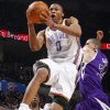 Photo - Oklahoma City's Russell Westbrook drives past Sacramento's Francisco Garcia during the NBA basketball game between the Oklahoma City Thunder and the Sacramento Kings at the Ford Center in Oklahoma City, Tuesday, March 2, 2010.  Photo by Bryan Terry, The Oklahoman ORG XMIT: KOD