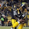 Photo - Pittsburgh Steelers wide receiver Antonio Brown (84) goes in for a touchdown as wide receiver Markus Wheaton (11) celebrates in the first quarter of an NFL football game against the Cincinnati Bengals on Sunday, Dec. 15, 2013, in Pittsburgh. (AP Photo/Don Wright)