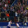 Photo - Atletico's Koke celebrates after scoring the opening goal with teammate Tiago, left, during the Champions League quarterfinal second leg soccer match between Atletico Madrid and FC Barcelona at the Vicente Calderon stadium in Madrid, Spain, Wednesday, April 9, 2014. (AP Photo/Andres Kudacki)