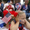 Claire Kasbaum, 3, holds her ears as a motorcycles drive by during the LibertyFest Parade, Saturday, July 3, 2010, in downtown Edmond, Okla. Photo by Sarah Phipps, The Oklahoman
