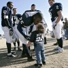 With his teammates watching on the sidelines, Brandon Davis, of Shawnee, gives his daughter Aubree (CQ) AUBREE, age 2, during the Shawnee Millers\' game against the Stillwater Outlaws in Shawnee, Okla., on Sunday, Jan. 13, 2007. By John Clanton, The Oklahoman