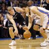 Thunder\'s Steven Adams (12) and Brooklyn\'s Mason Plumlee (1) fight for the ball in an NBA basketball game between the Oklahoma City Thunder and the Brooklyn Nets at the Chesapeake Energy Arena in Oklahoma City, on Thursday, Jan. 2, 2014. Photo by Steve Sisney, The Oklahoman