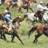 Riders re-enact the start of the Land Run at the Flying W Guest Ranch in Sayre in this 2007 photo. PHOTO BY STEVE SISNEY, OKLAHOMAN ARCHIVE