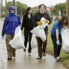 Andrea Sampley (left), Terra Dray, Sarah Reid, and Katie Votaw pick up trash along 15th Street in Edmond, OK, during Operation Clean Streets, a clean up effort in conjunction with the statewide Trash-Off Day, Saturday, April 17, 2010. By Paul Hellstern, The Oklahoman