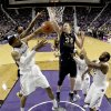 Photo - Kansas State's Shane Southwell, left, beats West Virginia's Kevin Noreen (34) to a rebound during the first half of an NCAA college basketball game Saturday, Jan. 18, 2014, in Manhattan, Kan. (AP Photo/Charlie Riedel)