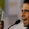 Opposition leader Henrique Capriles holds up a copy of the Venezuelan Constitution as he speaks during a news conference in Caracas, Venezuela, Wednesday, Jan. 9, 2013. Capriles condemned the Supreme Court\'s endorsement of delaying the inauguration.