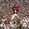 Oklahoma\'s Kenny Stills (4) catches a touchdown pass during the college football game between the University of Oklahoma Sooners (OU) and the Ball State Cardinals at Gaylord Family-Memorial Stadium on Saturday, Oct. 01, 2011, in Norman, Okla. Photo by Bryan Terry, The Oklahoman