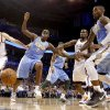 Oklahoma City\'s Nick Collison (4) and Oklahoma City\'s Serge Ibaka (9) fight Denver\'s Al Harrington (7) and J.R. Smith (5) for a loose ball during the NBA basketball game between the Oklahoma City Thunder and the Denver Nuggets, Friday, April 8, 2011, at the Oklahoma City Arena.. Photo by Sarah Phipps, The Oklahoman