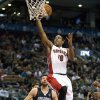Toronto Raptors guard DeMar DeRozan (10) drives to the basket against Orlando Magic forward Josh McRoberts (17) during the first half of an NBA basketball game in Toronto, Sunday, Nov. 18, 2012. (AP Photo/The Canadian Press, Frank Gunn)