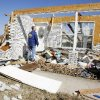 Rick Smith, warning coordination meteorologist, of WFO Norman\'s hazardous weather preparedness activities, looks at a damaged on Brock Road in Lone Grove Wednesday, Feb. 11, 2009. (AP Photo/ Paul B. Southerland)