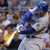Photo - Los Angeles Dodgers' Adrian Gonzalez drives in a run with a single off Pittsburgh Pirates starting pitcher Edinson Volquez during the fourth inning of a baseball game in Pittsburgh Monday, July 21, 2014. (AP Photo/Gene J. Puskar)