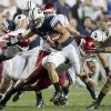 Photo -   BYU quarterback Riley Nelson runs the ball during the first half of the NCAA college football game between the BYU Cougars and the Washington State Cougars at LaVell Edwards Stadium in Provo, Utah on Thursday, Aug. 30, 2012. (AP Photo/Spenser Heaps, Daily Herald)