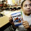 Breanna Acosta, a fourth grader at North Highland, poses with a copy of \'
