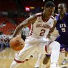 Oklahoma\'s Steven Pledger (2) drives past Stephen F. Austin\'s Antonio Bostic (5) during a college basketball game between the University of Oklahoma (OU) and Stephen F. Austin University at the Lloyd Noble Center in Norman, Okla., Tuesday, Dec. 18, 2012. Oklahoma lost 56-55. Photo by Bryan Terry, The Oklahoman