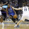 Oklahoma City\'s Kevin Durant (35) drives in between Memphis\' Tony Allen (9) and Beno Udrih (19) during Game 6 in the first round of the NBA playoffs between the Oklahoma City Thunder and the Memphis Grizzlies at FedExForum in Memphis, Tenn., Thursday, May 1, 2014. Photo by Bryan Terry, The Oklahoman