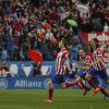 Atletico\'s Gabi , left, celebrates his goal during a Spanish La Liga soccer match between Atletico de Madrid and Real Madrid at the Vicente Calderon stadium in Madrid, Spain, Sunday, March 2, 2014. (AP Photo/Gabriel Pecot)
