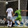 Vancouver Whitecaps\' goalkeeper Brad Knighton, bottom, stops a shot by Seattle Sounders\' Zach Scott as Whitecaps\' Jun Marques Davidson, left, of Japan, and Sounders\' Brad Evans watch during the first half of an MLS soccer match in Vancouver, British Columbia, on Saturday, July 6, 2013. (AP Photo/The Canadian Press, Darryl Dyck)