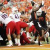 Oklahoma State\'s Joseph Randle (1) leaps into the end zone past Arizona\'s Saneilia Fuiamaono (99) and Paul Vassallo (41) in the first quarter Thursday. PHOTO BY NATE BILLINGS, The Oklahoman