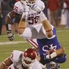 Oklahoma\'s Trey Millard (33) upends Kansas\' Nick Sizemore (45) on a kick return during the college football game between the University of Oklahoma Sooners (OU) and the University of Kansas Jayhawks (KU) on Sunday, Oct. 16, 2011. in Lawrence, Kan. Photo by Chris Landsberger, The Oklahoman