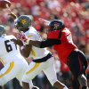 West Virginia\'s Geno Smith throws under pressure from Texas Tech\'s Kerry Hyder during an NCAA college football game in Lubbock, Texas, Saturday, Oct. 13, 2012. (AP Photo/Lubbock Avalanche-Journal, Stephen Spillman) LOCAL TV OUT
