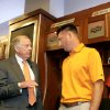 COLLEGE FOOTBALL / OSU: Oklahoma State University head football coach Mike Gundy, right talks with T. Boone Pickens in the locker room during a tour of the west end zone of Boone Pickens Stadium\'s facilities in Stillwater, Oklahoma August 17, 2009.They are standing in front of T. Boone Pickens\' locker. Photo by Steve Gooch, The Oklahoman ORG XMIT: KOD