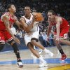 Russell Westbrook, middle, drives past Chicago\'s Derrick Rose, left, and Joakim Noah during last year\'s game on Jan. 27. The two teams play tonight in their NBA season opener. PHOTO BY CHRIS LANDSBERGER, THE OKLAHOMAN