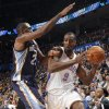 Memphis\' Quincy Pondexter (20) defends on Oklahoma City\'s Serge Ibaka (9) during the NBA basketball game between the Oklahoma City Thunder and the Memphis Grizzlies at Chesapeake Energy Arena on Wednesday, Nov. 14, 2012, in Oklahoma City, Okla. Photo by Chris Landsberger, The Oklahoman