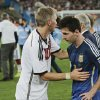 Photo - Germany's Bastian Schweinsteiger, left, consoles Argentina's Lionel Messi after the World Cup final soccer match between Germany and Argentina at the Maracana Stadium in Rio de Janeiro, Brazil, Sunday, July 13, 2014. Germany won the match 1-0 . (AP Photo/Matthias Schrader)