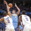 Denver\'s Danilo Gallinari (8) puts up a shot over Oklahoma City\'s Thabo Sefolosha (2) and Oklahoma City\'s Serge Ibaka (9) during the first round NBA playoff game between the Oklahoma City Thunder and the Denver Nuggets on Sunday, April 17, 2011, in Oklahoma City, Okla. Photo by Chris Landsberger, The Oklahoman