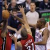 Oklahoma City\'s Kevin Durant (35) passes the ball between Miami\'s Dwyane Wade (3) and Miami\'s Shane Battier (31) during Game 1 of the NBA Finals between the Oklahoma City Thunder and the Miami Heat at Chesapeake Energy Arena in Oklahoma City, Tuesday, June 12, 2012. Photo by Sarah Phipps, The Oklahoman