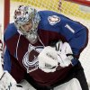 Photo - Colorado Avalanche goalie Semyon Varlamov (1), of Russia, makes a save against the Minnesota Wild during the first period of an NHL hockey game Thursday, Jan. 30, 2014, in Denver. (AP Photo/Barry Gutierrez)