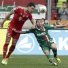 Photo - Bayern's Daniel van Buyten of Belgium, left, and Augsburg's Sascha Moelders challenge for the ball during the German first division Bundesliga soccer match between FC Augsburg and FC Bayern Munich, in Augsburg, southern Germany, Saturday, April 5, 2014. (AP Photo/Matthias Schrader)