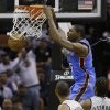 Oklahoma Thunder\'s Kevin Durant, center, scores over San antonio Spurs\' Tim Duncan (21) and Kawhi Leonard (2) during the second quarter of an NBA basketball game, Thursday, Nov. 1, 2012, in San Antonio. (AP Photo/Eric Gay) ORG XMIT: TXEG106