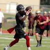 Photo - Westmoore's  Stephan Robinson makes a catch during a 7 on 7 tournament game at Westmoore High School in Moore, Okla.,  Saturday, June 28, 2014. Photo by Sarah Phipps, The Oklahoman